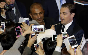 "Photo - Actor Leonardo DiCaprio signs autographs for fans during the premiere of his new film ""Django Unchained"" in Seoul, South Korea, Thursday, March 7, 2013. DiCaprio is in Seoul to promote the film which is to be released in South Korea on March 21. (AP Photo/Lee Jin-man)"