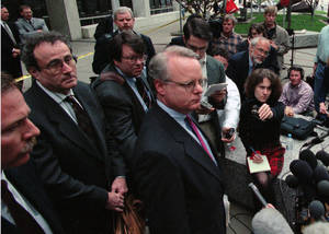 Photo -   FILE - In this May 8, 1998, file photo, lead tobacco attorney Peter Bleakley, second from left, stands by as tobacco industry spokesman Scott Williams, right, addresses the media outside the St. Paul courthouse, where the state of Minnesota agreed to a $6-billion settlement of its lawsuit against tobacco companies. More than 2,400 retired NFL football players are now plaintiffs, looking for the kind of success smokers had against the tobacco companies. (AP Photo/Jim Mone, File)