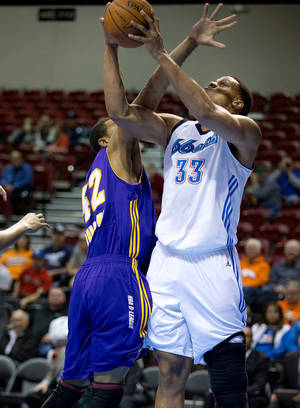 Photo - The 66ers Daniel Orton, right, is fouled during D-League action against Los Angeles on Jan. 25.  Photo courtesy Tulsa World