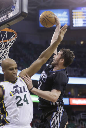 Photo - Minnesota Timberwolves' Kevin Love, right, dunks the ball as Utah Jazz's Richard Jefferson (24) defends in the second quarter during an NBA basketball game, Tuesday, Jan. 21, 2014, in Salt Lake City. (AP Photo/Rick Bowmer)
