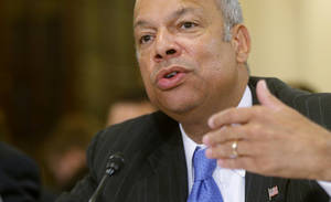 Photo - FILE - In this June 24, 2014, file photo, Homeland Security Secretary Jeh Johnson testifies on Capitol Hill in Washington. Johnson is ordering increased security measures at some overseas airports offering direct flights to the United States. The Homeland Security Department would not immediately say July 2 whether the increased measures were in response to intelligence about a specific threat. But a U.S. counterterrorism official says American intelligence has seen indications that certain terrorist groups in Yemen and Syria are working on a bomb that could make it through airport security undetected.  (AP Photo/Charles Dharapak, File)