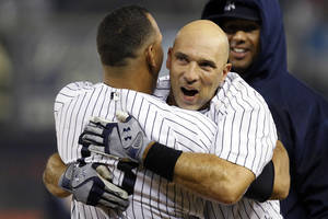 Photo -   New York Yankees' Alex Rodriguez, left, embraces Raul Ibanez after Ibanez hit a 12th inning, walk-off RBI single to give the Yankees a 4-3 win in their baseball game against the Boston Red Sox at Yankee Stadium in New York, Tuesday, Oct. 2, 2012. (AP Photo/Kathy Willens)