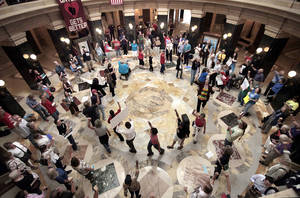 Photo -   In this Sept. 7, 2012 photo, dozens of singers gather in the state Capitol rotunda for the 455th consecutive Solidarity sing along in the wake of a crackdown on protests without a permit by new Capitol Police Chief David Erwin. Most of the demonstrations against Wisconsin Gov. Scott Walker ended a long time ago. But every weekday at noon, a few dozen people still gather inside the state Capitol and sing protest songs for an hour. (AP Photo/Wisconsin State Journal, John Hart)