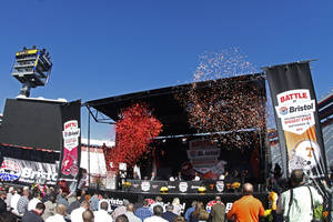 Photo - Confetti is fired into the sky during a press conference at Bristol Motor Speedway Monday, Oct. 14, 2013, in Bristol, Tenn.,  where it was announced that Tennessee and Virginia Tech will play a football game at the speedway in 2016. (AP Photo/Wade Payne)