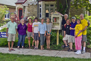 Photo - A Little Free Library is shown in a neighborhood in Milwaukee. PHOTO PROVIDED