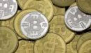 Photo - Some Bitcoins are pictured in this photo illustration in Sandy, Utah, January 31, 2014. REUTERS/Jim Urquhart