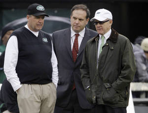 "Photo - FILE - In this Dec. 2, 2012 file photo, New York Jets head coach Rex Ryan, left, stands with general manager Mike Tannenbaum, center, and owner Woody Johnson before an NFL football game against the Arizona Cardinals in East Rutherford, N.J. The New York Jets have fired Tannenbaum and say Ryan will be back next season. Johnson said in a statement Monday, Dec. 31, 2012, that ""like all Jets fans, I am disappointed with this year's results."" (AP Photo/Kathy Willens, File)"