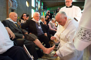 "Photo -  In this picture made available by the Vatican newspaper L'Osservatore Romano, Pope Francis washes the foot of a man at the Don Gnocchi Foundation Center in Rome on Thursday.  The pontiff washed the feet of 12 elderly and disabled people — women and non-Catholics among them — in a pre-Easter ritual designed to show his willingness to serve like a ""slave."" AP Photo/L'Osservatore Romano  <strong></strong>"