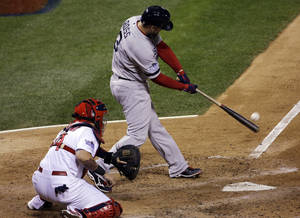 Photo - Boston Red Sox's David Ross hits an RBI double during the seventh inning of Game 5 of baseball's World Series against the St. Louis Cardinals Monday, Oct. 28, 2013, in St. Louis. (AP Photo/David J. Phillip)