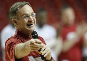 "Photo - Oklahoma head coach Lon Kruger speaks to fans before the start of ""Hoops Jam,"" an NCAA college basketball event in Norman, Okla., Sunday, Oct. 16, 2011. AP PHOTO <strong>Sue Ogrocki</strong>"