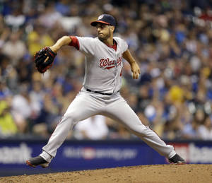 Photo - Washington Nationals starting pitcher Gio Gonzalez throws to the Milwaukee Brewers during the sixth inning of a baseball game Monday, June 23, 2014, in Milwaukee. (AP Photo/Jeffrey Phelps)