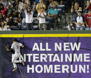 Photo -   Miami Marlins center fielder Gorkys Hernandez goes up against the wall as he chases down a triple by Atlanta Braves' Jason Heyward during the sixth inning of a baseball game Tuesday, Sept. 25, 2012, in Atlanta. (AP Photo/David Goldman)