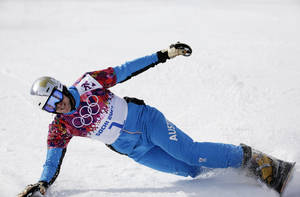 Photo - Austria's Benjamin Karl celebrates after taking the bronze medal in the men's snowboard parallel slalom final at the Rosa Khutor Extreme Park, at the 2014 Winter Olympics, Saturday, Feb. 22, 2014, in Krasnaya Polyana, Russia. (AP Photo/Andy Wong)