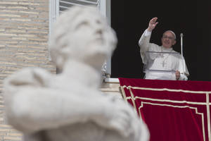 Photo - Pope Francis delivers his blessing to the crowd gathered in St. Peter's Square at the Vatican to attend the Angelus noon prayer he celebrated from the window of his studio, Sunday, Feb. 16, 2014. (AP Photo/Andrew Medichini)
