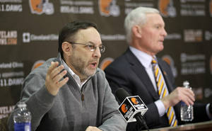 Photo - Cleveland Browns CEO Joe Banner answers questions during a news conference at the Browns' training facility Monday, Dec. 30, 2013, in Berea, Ohio. Owner Jimmy Haslam, right, listens. Head coach Rob Chudzinski was fired Sunday. (AP Photo/Tony Dejak)