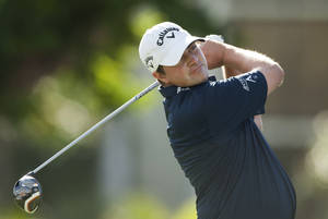 Photo - Brian Stuard follows his drive off the first tee during the second round of the Sony Open golf tournament, Friday, Jan. 10, 2014, in Honolulu. (AP Photo/Marco Garcia)