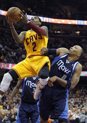 Photo -   Cleveland Cavaliers' Kyrie Irving (2) shoots against Dallas Mavericks' Shawn Marion in the fourth quarter of an NBA basketball game on Saturday, Nov. 17, 2012, in Cleveland. Irving scored 26 points in the 103-95 loss to Dallas. (AP Photo/Mark Duncan)