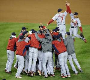 Photo -   Members of the St. Louis Cardinals celebrate after Game 5 of the National League division baseball series against the Washington Nationals on Saturday, Oct 13, 2012, in Washington. St. Louis won 9-7. (AP Photo/Nick Wass)