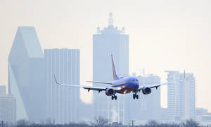 Photo - A Southwest Airlines jet plane lines up for a landing Monday at Love Field in Dallas.                     AP Photo