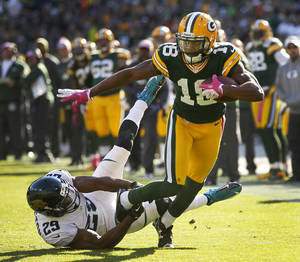 Photo -   Green Bay Packers wide receiver Randall Cobb tries to get away from Jacksonville Jaguars cornerback William Middleton during the second half of an NFL football game Sunday, Oct. 28, 2012, in Green Bay, Wis. The Packers won 24-15. (AP Photo/Mike Roemer)
