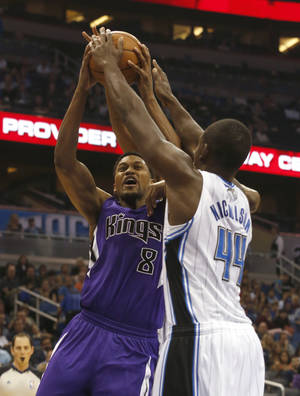 Photo - Sacramento Kings forward Rudy Gay (8) shoots as Orlando Magic forward Andrew Nicholson (44) tries to block his shot during the first half of an NBA basketball game Saturday, Dec. 21, 2013, in Orlando, Fla. (AP Photo/Reinhold Matay)