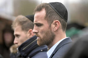 photo - Schalke's player Christoph Metzelder listens to a prayer at a new memorial plaque at the stadium of Bundesliga soccer club FC Schalke 04, dedicated to the forgotten Jewish club members who were persecuted and murdered during the holocaust, Gelsenkirchen, western Germany, Wednesday, Jan. 30, 2012. Schalke was the most successful club in Nazi Germany and won the championship 6 times between 1934 and 1942. (AP Photo/Martin Meissner)