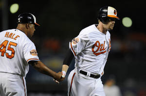 Photo -   Baltimore Orioles' Matt Wieters, right, is greeted by third base coach DeMarlo Hale (45) after he hit a three-run home run against the New York Yankees during the first inning of a baseball game, Thursday, Sept. 6, 2012, in Baltimore. (AP Photo/Nick Wass)