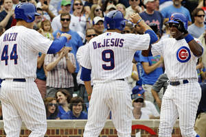 Photo -   Chicago Cubs' Alfonso Soriano, right, celebrates with Anthony Rizzo, left, and David DeJesus after hitting a three-run home run against the San Francisco Giants during the fifth inning of a baseball game in Chicago, Sunday, Sept. 2, 2012. (AP Photo/Nam Y. Huh)