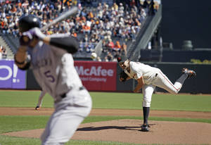photo -   San Francisco Giants starting pitcher Barry Zito, right, throws against Colorado Rockies' Carlos Gonzalez, left, during the first inning of a baseball game in San Francisco, Thursday, Sept. 20, 2012. (AP Photo/Eric Risberg)