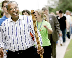 Photo - In this 2007 photo, the Rev. Robert Hayes Jr., bishop of the Oklahoma United Methodist Conference, leads a group on a Walk for Health and Wholeness on the Oklahoma City University campus during the conference's annual meeting.  <strong>John Clanton - The Oklahoman</strong>