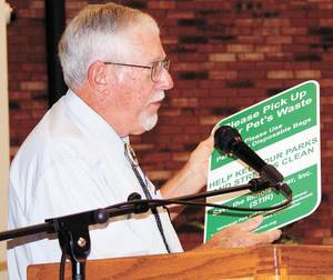 Photo - Ed Brocksmith, treasurer of Save The Illinois River Inc., discusses waste and its effect on the watershed. (Tahlequah Daily Press photo)