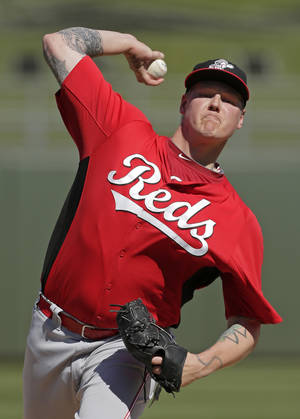 photo - Cincinnati Reds starting pitcher Mat Latos throws during the second inning of an exhibition spring training baseball game against the Kansas City Royals, Friday, March 1, 2013, in Surprise, Ariz. (AP Photo/Charlie Riedel)
