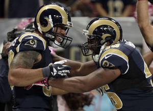 Photo - St. Louis Rams tight end Lance Kendricks, left, is congratulated by Cory Harkey after catching a 16-yard pass for a touchdown during the second quarter of an NFL football game against the Jacksonville Jaguars Sunday, Oct. 6, 2013, in St. Louis. (AP Photo/Tom Gannam)