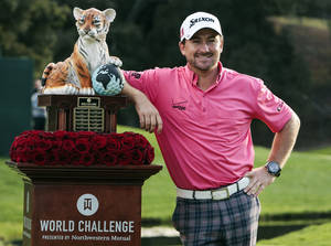 Photo - Graeme McDowell poses with the trophy after winning the World Challenge golf tournament at Sherwood Country Club in Thousand Oaks, Calif., Sunday, Dec. 2, 2012. (AP Photo/Bret Hartman)