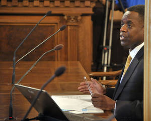 Photo - Detroit's emergency manager Kevyn Orr testifies before the House committee on Detroit's bankruptcy, at the State Capitol in Lansing, Mich., Tuesday, May 13, 2014. (AP Photo/The Detroit News, Dale G. Young) DETROIT FREE PRESS OUT; HUFFINGTON POST OUT.