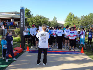 photo - Janet Peery, CEO of YWCA Oklahoma City, addresses runners at the starting line before the organization's 2-Minute 5K race.  PHOTO BY TIFFANY M. POOLE, THE OKLAHOMAN. <strong></strong>