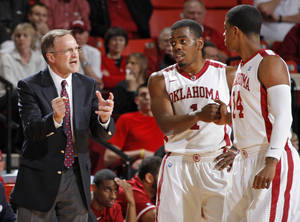 Photo - OU head coach Lon Kruger talks to Sam Grooms (1) and Carl Blair (14) in the first half during a men's college basketball game between the University of Oklahoma Sooners and University of Missouri Tigers at the Lloyd Noble Center in Norman, Okla., Monday, Feb. 6, 2012.  Photo by Nate Billings, The Oklahoman