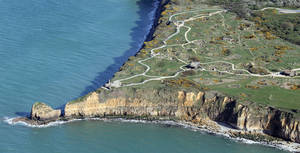 "Photo - The ""Pointe du Hoc"" is pictured Tuesday, April 8, 2014 near Caen, Normandy, France. It was the highest point during WWII between Utah Beach and and Omaha Beach. The Germans fortified the area with concrete bunkers and gun pits. On D-Day (June 6, 1944) the United States Army successfully assaulted Point du Hoc after scaling the cliffs. France is preparing to mark the 70th anniversary of the D-Day invasion which took place on June 6, 1944. (AP Photo/David Vincent)"