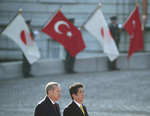 Photo - Turkish Prime Minister Recep Tayyip Erdogan, left, and Japanese Prime Minister Shinzo Abe attend a welcome ceremony at Akasaka State Guest House in Tokyo, Tuesday, Jan. 7, 2014. (AP Photo/Koji Sasahara)