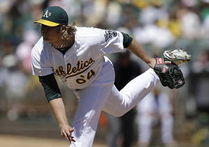 Photo - Oakland Athletics' A.J. Griffin works against the Tampa Bay Rays in the first inning of a baseball game Sunday, Sept. 1, 2013, in Oakland, Calif. (AP Photo/Ben Margot)