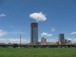 Photo - Devon Energy Center can be seen to the north of where a proposed Core to Shore park will be built as part of MAPS 3. Interstate 40, shown in front of the Devon tower, is set to be replaced with a six-lane boulevard. This shot was taken at SW 4 and Harvey Avenue. <strong>Steve Lackmeyer</strong>