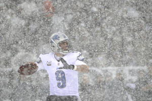 Photo - Detroit Lions' Matthew Stafford drops back to pass during the first half of an NFL football game against the Philadelphia Eagles, Sunday, Dec. 8, 2013, in Philadelphia. (AP Photo/Matt Rourke)