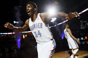 Photo - Oklahoma City's Hasheem Thabeet (34) runs past Russell Westbrook (0) as he is announced as a starter before an NBA basketball game between the Oklahoma City Thunder and the Sacramento Kings at Chesapeake Energy Arena in Oklahoma City, Monday, April 15, 2013. Photo by Nate Billings, The Oklahoman