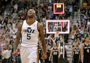 Photo - Utah Jazz point guard Mo Williams (5) celebrates after scoring the game-winning shot an the end of their NBA basketball game against the San Antonio Spurs Wednesday, Dec. 12, 2012, in Salt Lake City. The Jazz defeated the Spurs 99-96. (AP Photo/Rick Bowmer)