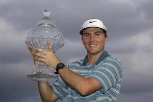 Photo - Russell Henley holds up his trophy after winning the Honda Classic golf tournament on Sunday, March 2, 2014, in Palm Beach Gardens, Fla. (AP Photo/Wilfredo Lee)