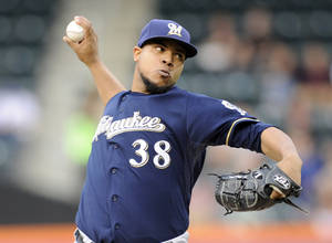 Photo - Milwaukee Brewers pitcher Wily Peralta delivers the ball to the New York Mets during the first inning of a baseball game on Wednesday, June 11, 2014, at Citi Field in New York. (AP Photo/Bill Kostroun)