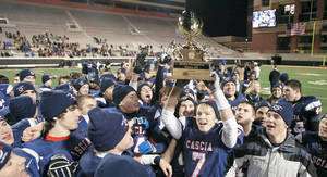 Photo - Cascia Hall fans, players and staff celebrate after the Class 3A Championship game at Boone Pickens Stadium, in Stillwater on Friday. Photo by CORY YOUNG, Tulsa World