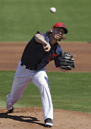 Photo - Cleveland Indians starting pitcher Josh Tomlin delivers against the Milwaukee Brewers in the first inning of a spring exhibition baseball game on Sunday, March 9, 2014, in Goodyear, Ariz. (AP Photo/Mark Duncan)