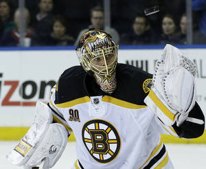Photo - Boston Bruins goalie Tuukka Rask makes a save during the second period of the NHL hockey game against the New York Rangers, Sunday, March 2, 2014, in New York. (AP Photo/Seth Wenig)