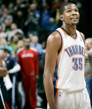 Photo - Kevin Durant smiles as time runs out of the Thunder's 103-94 win over Atlanta on Friday. PHOTO BY JOHN CLANTON, THE OKLAHOMAN